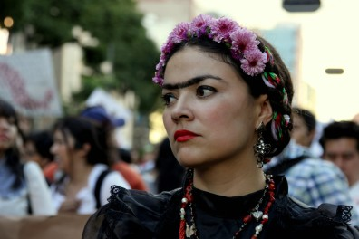 A protestor dressed as Frida Kahlo in mourning