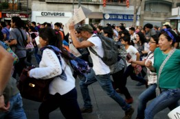 Protestors run to catch up with the march, Mexico City