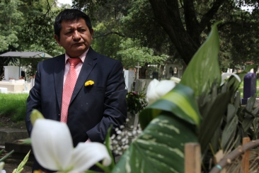 Pedro Canche visits his friend's gravesite