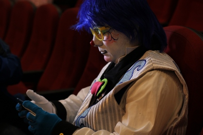 Jose Antonio Larraga Montes, 'clown Leperony Bombom', looks at his Facebook account to see the latest threats put out by clown-hunting groups. He's afraid they'll try to hurt him and says that now going out in his clown costume has become stressful.