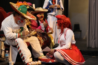 The clown community uses the event as a time to trade tricks of the trade and show off their costumes.