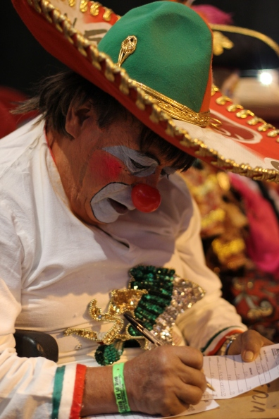 As the clowns compete for best costume and make up design, they all dress to impress. Some got up at 4am to get their outfits ready. This clown judge wears a typical oversize Mexican sombrero as part of his persona.