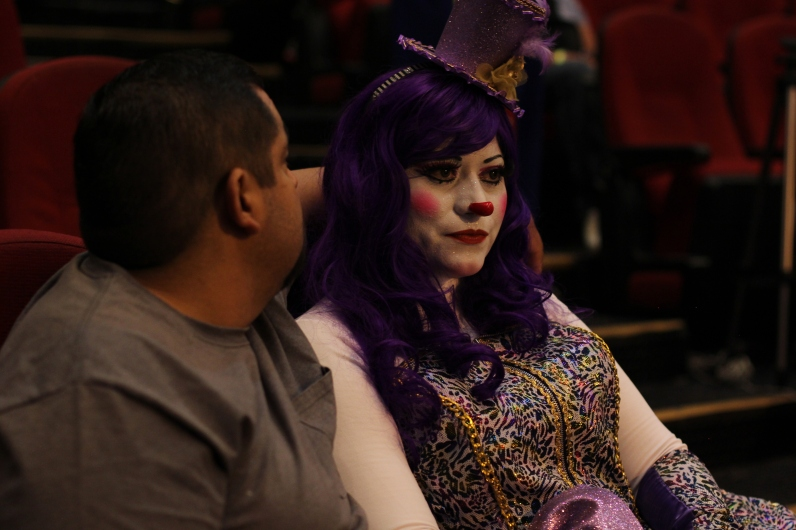 A prestigious highlight of the annual clown convention is the make up and costume competition. Clowns watch each other parade and explain their personas.