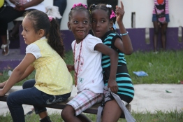 Kids play in a park during Garifuna Landing Day celebrations in Belize.